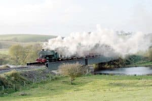 A steam train crossing the River Quoile Bridge