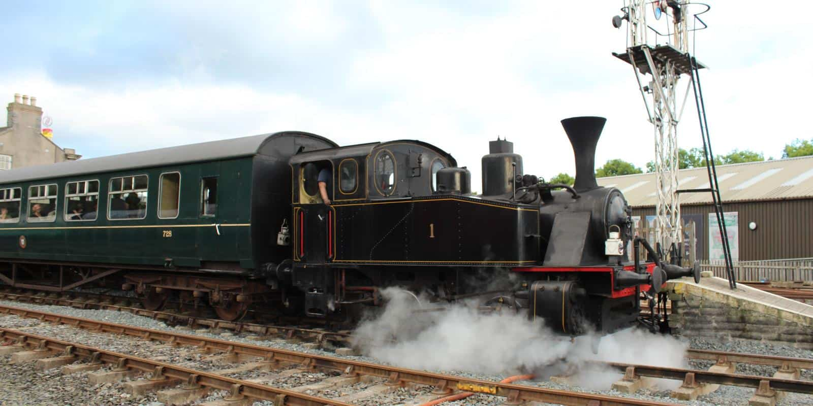 Our steam train sets off on a charter trip from Downpatrick Station