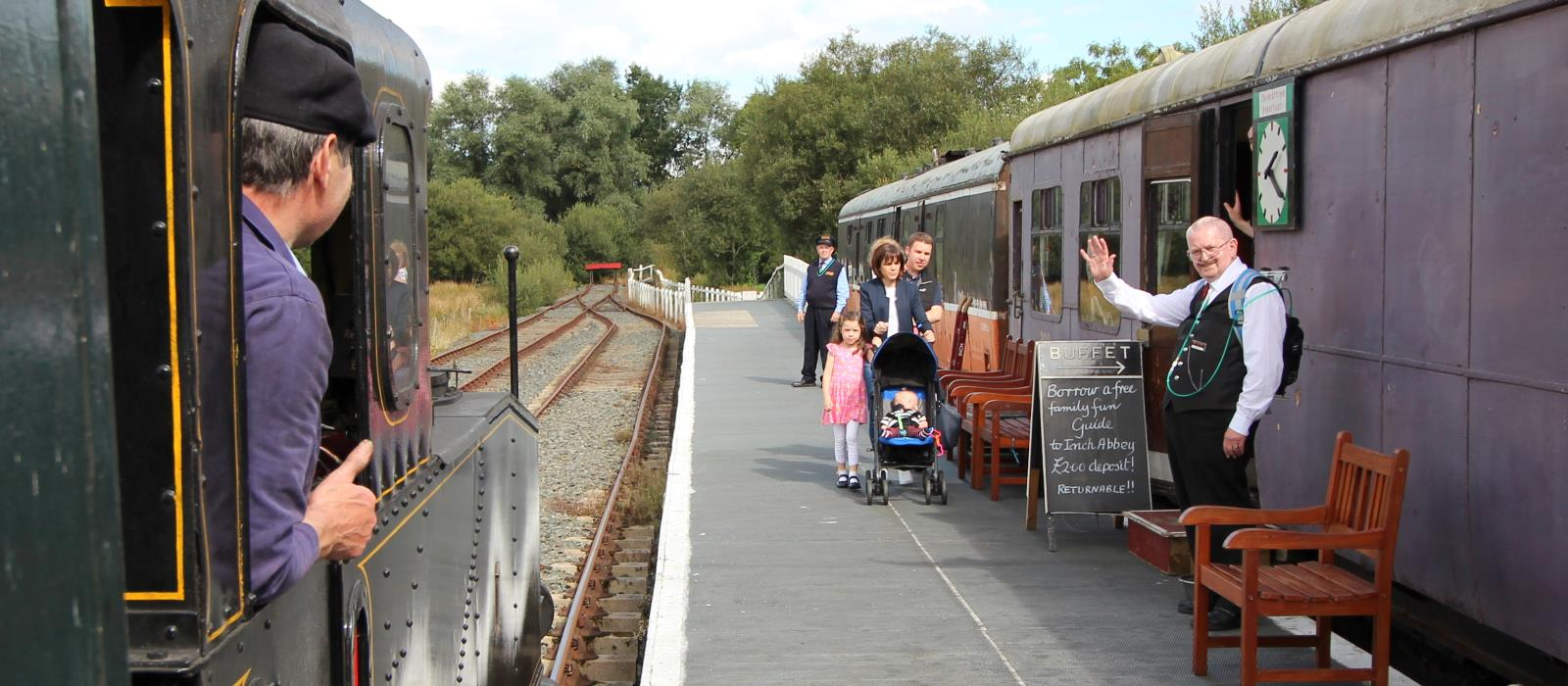 Our steam train arrives into Inch Abbey Station, greeted by a friendly wave from buffet manager Andrew.