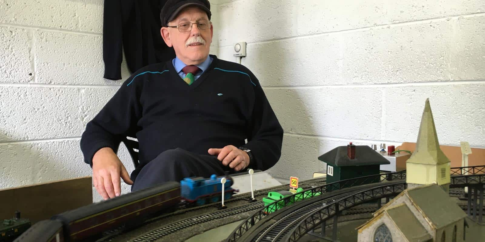 Dessie in control as Thomas races past on the model railway