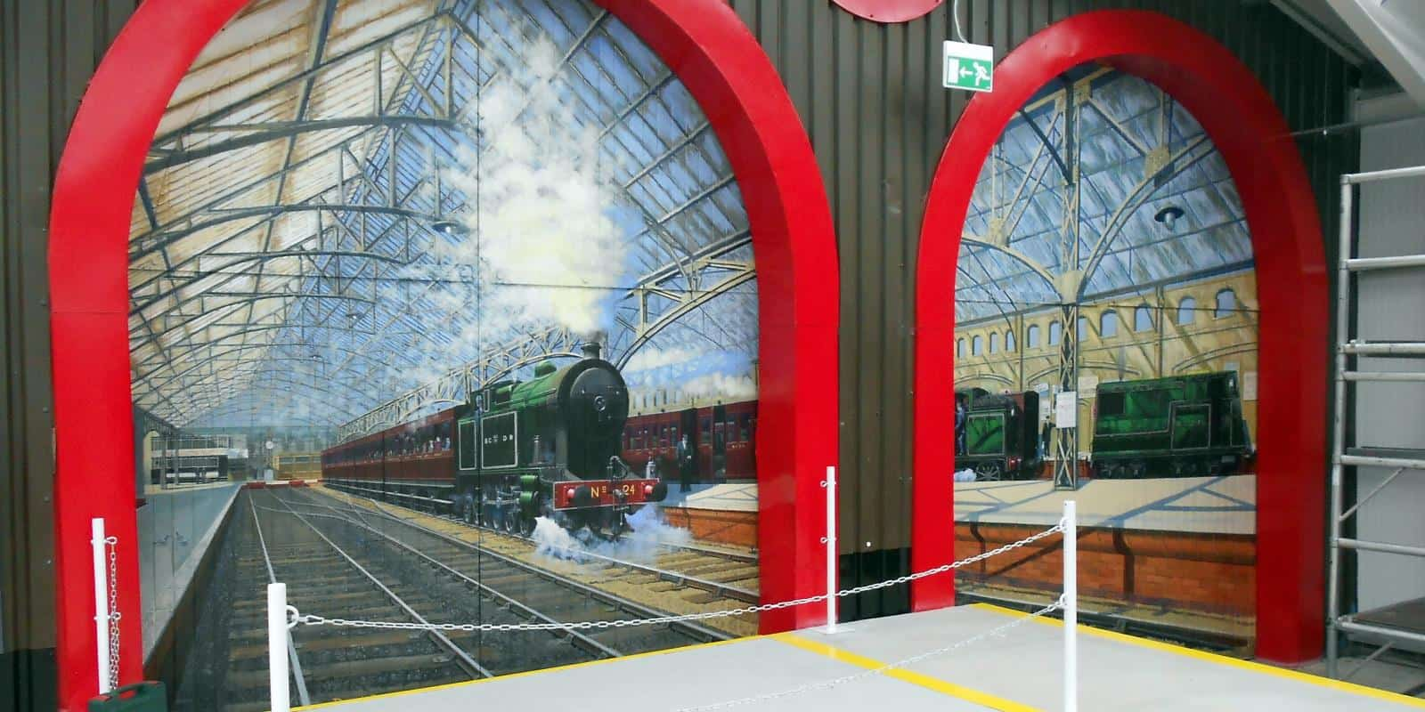 Murals of BCDR's Queen's Quay Station in our carriage gallery
