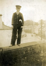 Porter Bob Seales standing on the bridge that carried the main line and Newtownards line over Comber's Glen Road in 1941.