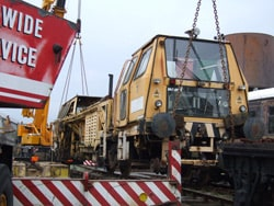 The Tamper being craned on to the track at Downpatrick