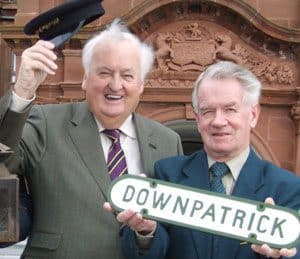 Dr. Billy Hastings (left) and DCDR vice-chair John Wilson (right) underneath the old BCDR coat of arms still guarding the entrance to the Slieve Donard Hotel launch the series of commemorative events