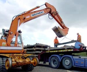 Daewoo excavator off-loading concrete sleepers at Downpatrick