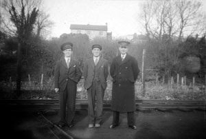 (left to right) William (Billy) Macrory, William (Willy) Irvine and Station Master James Taylor on the last day of service