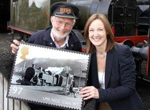 DCDR volunteer Philip McKinstry and the Royal Mail's Barbara Roulston launch the Great British Railways series of stamps in Downpatrick, in front of GSWR No. 90 Photo: Chris Halpin, Mourne Observer