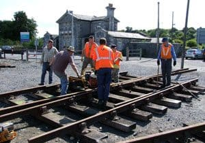 The Irish Rail and DCDR team dismantling and loading the various component parts of the turnout in Bagenalstown Railway Station yard