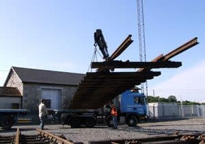 The overall dimensions of the turnout are 90ft long by 15ft wide, therefore a specialised crane lorry was needed to load and transport the materials north. As much as possible was lifted intact, but the majority was dismantled. Sleepers have been numbered to make reassembly easier in Downpatrick