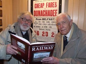 Desmond Coakham (right) and Andy Crockart (left) inspect a copy of the book in the foyer during the Book Launch