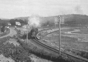 The 'Golfers Express' on the curve between Dundrum and Newcastle pre-1950. headed by 4-4-2T loco No. 18