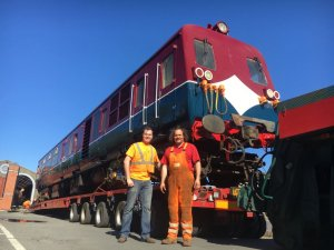 Robert Gardiner of DCDR (left) with Simon Reid, of Reid Freight Services, before power car 69 is unloaded.