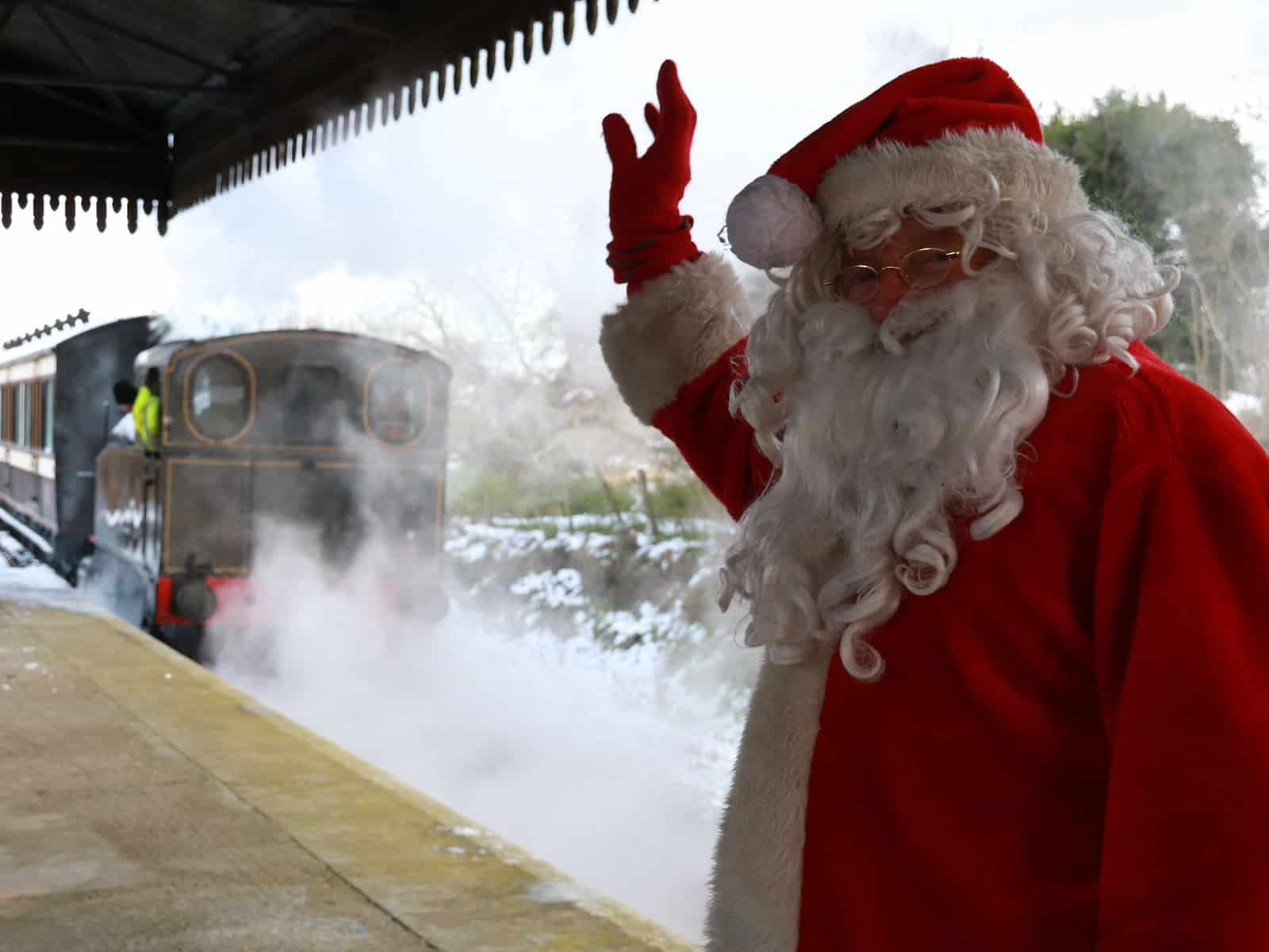 Santa and his steam train in the snow