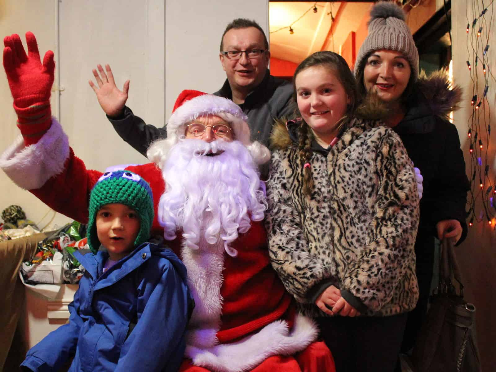 Happy families Ho-ho-ho-ing with Santa